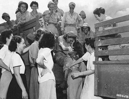 Arriving U.S. Army Nurses are excitedly welcomed by nurses that had been internees at Santo Tomas for the past 3 years, Manila, Philippines, Feb. 1945