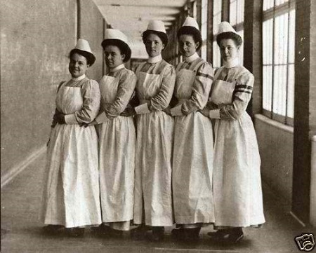 Nurses wearing early Nursing uniforms