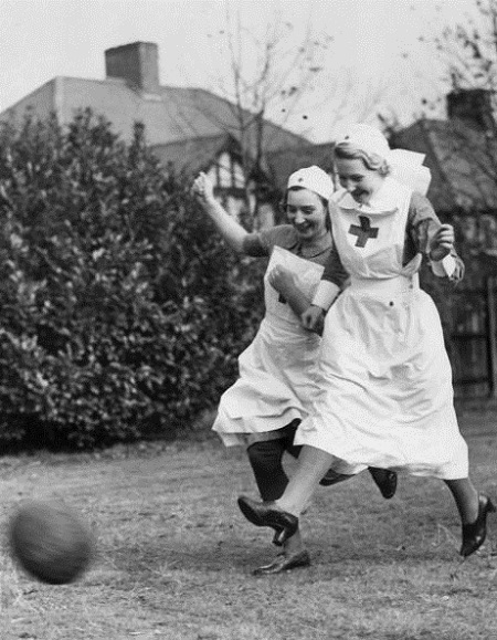 Red Cross nurses playing football, 1939.