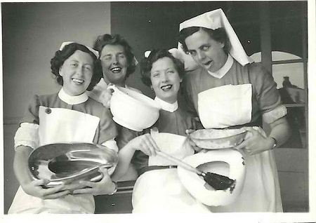 Vintage nurses having some bedpan humor.